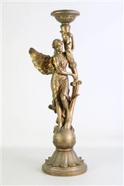 Sale 8923B - Lot 83 - A figural candlestick with an angel. Height 41cm