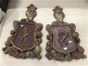 Sale 9059 - Lot 1021 - A pair of carved timber coat of arms (H: 62 x W: 38cm)