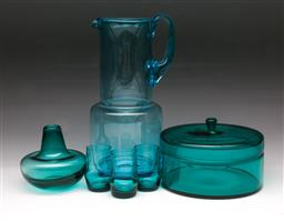 Sale 9107 - Lot 96 - A group of assorted teal coloured glassware including a jug, a lidded circular dish, a squat bulbous vase and three bud vases. Heigh...