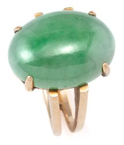 Sale 9124 - Lot 444 - A 14CT GOLD JADE RING; claw set with an 18 x 13mm cabochon variegated natural (Fei Cui) green jadeite jade type A, on a split shank...