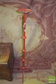 Sale 8359 - Lot 1709 - Red Painted Iron Candle Stick