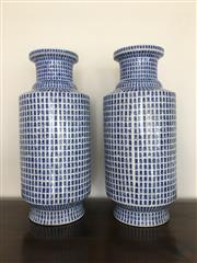Sale 8782A - Lot 31 - A pair of Chinese blue and white calligraphic inspired rouleau vases, height 50cm