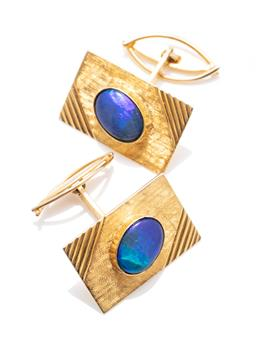 Sale 9253J - Lot 340 - A PAIR OF VINTAGE 9CT GOLD OPAL CUFFLINKS; 26 x 17mm Florentine engraved rectangular plaques each collet set with as oval opal tripl...