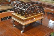 Sale 8282 - Lot 1022 - Victorian Walnut Canterbury, with pierced dividers, a drawer & turned legs