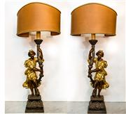 Sale 8516A - Lot 6 - A pair of handmade and hand-carved giltwood, & water gilded Venetian lamps, featuring a maiden supporting a semi circular lightshade...