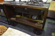 Sale 8523 - Lot 1041 - Open Bookcase with Industrial Wheels