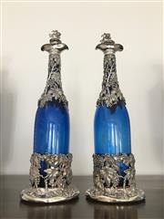 Sale 8782A - Lot 32 - A pair of Early C19th Bristol blue glass wine decanters with Victorian sterling silver casework decorated in fruiting vine pattern w...