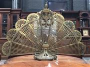 Sale 8882 - Lot 1068 - Louis XVI Style Brass Fire Guard, folding peacock style, with portrait bust and swags