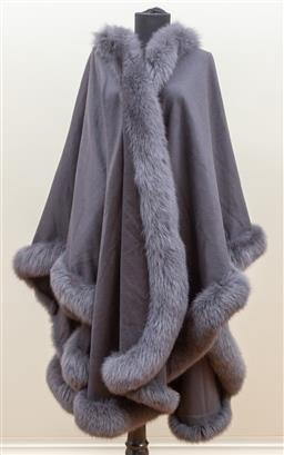 Sale 9165H - Lot 77 - A House of Cashmere fox fur lined cape in an elegant grey, one size fits most.