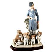 Sale 8000 - Lot 62 - A Lladro figural group of a Huntmaster and dogs, printed and signed to base, numbered 376.