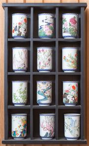 Sale 8515A - Lot 55 - Two open wall ebonised timber display cases the first with Japanese calendar flower of the seasons cups, the second with saucers, H...
