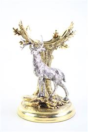 Sale 8832 - Lot 74 - A Franklin Mint Collectors Pocket Watch Stand, Gold Finished with Stag, Designed by Rick Fields H:10cm