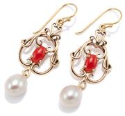 Sale 9074 - Lot 375 - A PAIR OF NOUVEAU STYLE PEARL AND CORAL EARRINGS; 9ct gold scrolling frames each centring a cabochon coral suspending a 7.4 x 9mm cu...