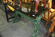 Sale 8312 - Lot 1059 - Glass Top Outdoor Table on Iron Base