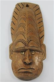 Sale 8520T - Lot 30 - Soloman Islands Mask/plaque. 42 cm x 18 across at ears. Shell operculum eyes, carved brown wood.