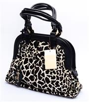 Sale 8921 - Lot 8 - A BALLY ANIMAL PRINT AND LEATHER HANDBAG; trimmed calf hair with giraffe print design to black leather trim, rolled handles and tag,...