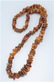 Sale 9037F - Lot 70 - A GRADUATED AMBER BEAD NECKLACE; 8 - 20mm freeform amber beads, length 70cm.
