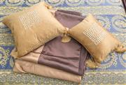 Sale 8470H - Lot 327 - Two gold silk tasselled cushions, together with two chocolate and gold silk single bed coverlets