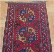Sale 8562A - Lot 15 - A Caucasian carpet runner with repeating geometric lozenges on red ground, 195 x 65cm, together with a smaller example, 90 x 54cm
