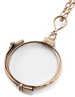 Sale 9124 - Lot 447 - A PAIR OF ANTIQUE GOLD PLATED PINCE-NEZ ON A GOLD CHAIN; 34mm round frames with decorative handle on a fine oval link 9ct gold chain...