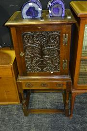 Sale 7987A - Lot 1009 - Antique Carved Oak Cabinet on Stand, the Door with Flower Motif & with Turned Leg Stretcher Base