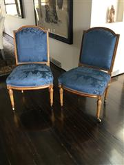 Sale 8782A - Lot 65 - A Pair of antique French carved and gilt chairs, upholstered in vintage blue chinoiserie silk, with castors to front legs. Height of...