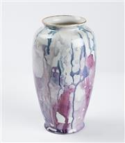 Sale 8855D - Lot 611 - A drip glaze ceramic vase with gilt rim. inscribed to base 'Hand painted by P. Ditchfield'. Ht: 16cm