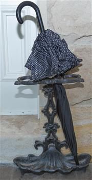 Sale 8435A - Lot 2 - A cast iron black painted umbrella stand with shell base, H 58cm