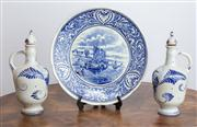 Sale 8650A - Lot 67 - A pair of Dutch blue and white stoppered oil bottles and another similar themed plate, Diameter 25cm.