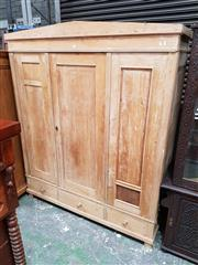 Sale 8848 - Lot 1083 - Rustic Pine Wardrobe, with three panel doors & three drawers