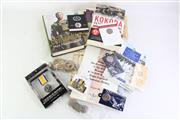 Sale 8852 - Lot 64 - A Box of Military Wares inc Books, Replica Medals and Badges
