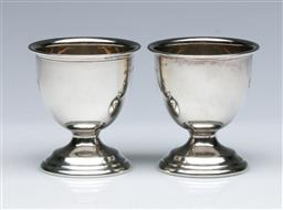 Sale 9098 - Lot 89 - A pair of sterling silver egg holders H5cm