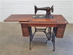 Sale 9157 - Lot 1062 - Early singer sewing machine on treadle base (h78 x w90 x d44cm)
