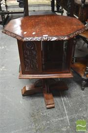 Sale 8291 - Lot 1060 - Possibly Late Victorian Oak Revolving Bookcase, of single tier, the octagonal top with carved rim & floral fascia below