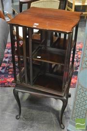 Sale 8345 - Lot 1006 - Edwardian Mahogany Revolving Bookcase, of two tiers & raised on cabriole legs