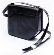 Sale 8921 - Lot 34 - A BALLY BLACK LEATHER CROSS BODY CORNER BAG; in textured leather with front flap, sliced corner detail and silver tone hardware to a...