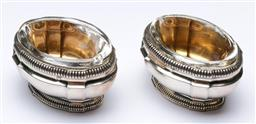 Sale 9164 - Lot 246 - A pair of Russian silver salts with clear glass linings (W:7cm)