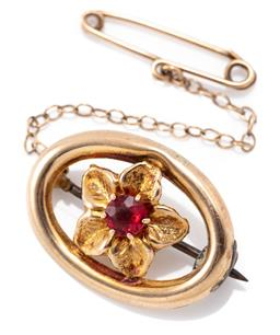 Sale 9186 - Lot 375 - A VINTAGE 9CT GOLD STONE SET FLORAL BROOCH; central flower set with a red paste to oval frame stamped 9ct Apex, size 23 x 17mm, with...