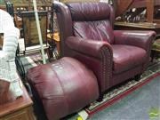 Sale 8495F - Lot 1018 - Leather Armchair and Stool