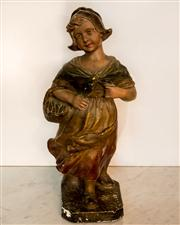 Sale 8516A - Lot 13 - A French plaster figure of a Dutch girl holding a basket of fish, titled Sur La Plage (meaning on the beach), signed. 40cm high...