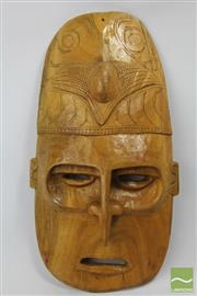 Sale 8520T - Lot 34 - Carved Cultural Mask  L 54 cm W 28cm