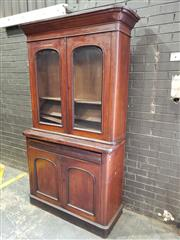 Sale 8976 - Lot 1061 - Late 19th century Cedar Bookcase, with two arched panel doors, long drawer & two further panel doors (h:230 x w:123 x d:50cm)