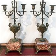 Sale 8516A - Lot 14 - A pair of ornate French dark rouge marble based bronze candelabras, circa 1900s. 47cm high x 13cm wide x 10cm deep