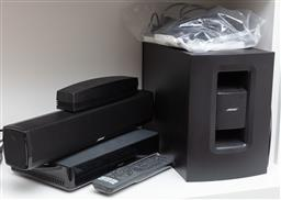 Sale 9134H - Lot 80 - A Bose CineMate 120 Sound system including speaker Array, wireless adapter, control console and digital home theatre speaker