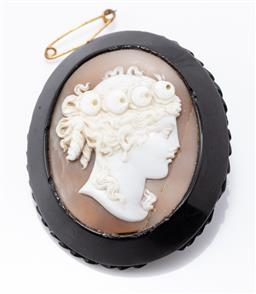 Sale 9180E - Lot 20 - A Victorian jet and shell cameo brooch, with losses, Length 6cm
