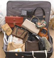 Sale 8375A - Lot 93 - A suitcase full of handbags