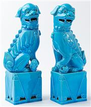 Sale 9083N - Lot 49 - A pair of Chinese blue glazed porcelain foo dogs on square bases. Height 37cm