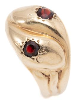 Sale 9145 - Lot 370 - A VINTAGE 9CT GOLD GARNET SNAKE RING; featuring entwined snake heads set with round cut garnets, size T, width 13mm, wt. 3.68g.