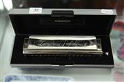 Sale 8324 - Lot 38 - The Larry Adler Professional 16 Chromatic Harmonica by M. Hohner