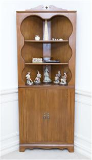 Sale 8402H - Lot 8 - A corner cabinet with three shelves above cupboard doors. Height 190cm, width 74cm.